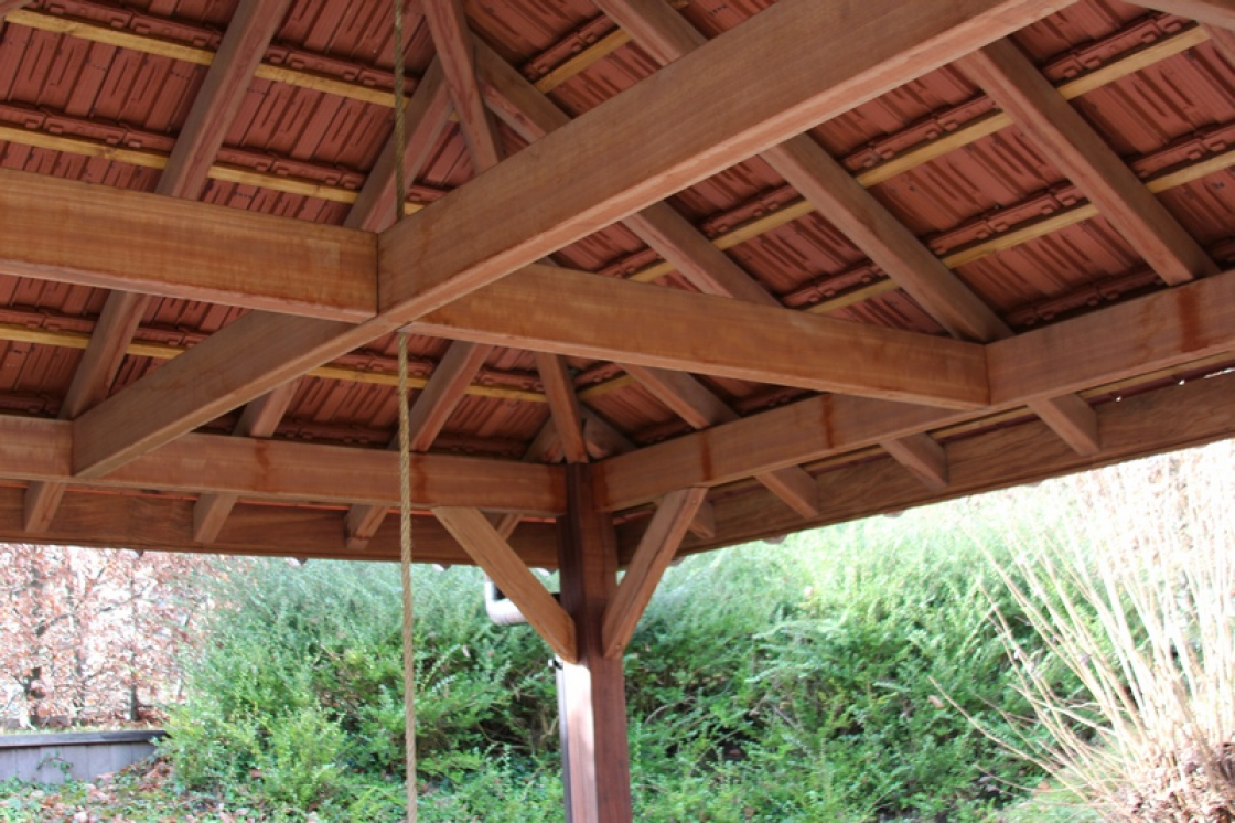 When you install a wooden pergola against the side of your house, it can be used as a sun screen.